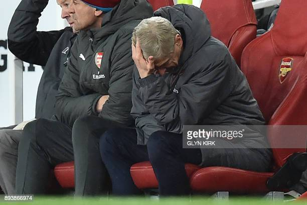 Arsenal's French manager Arsene Wenger gestures in his seat during the English Premier League football match between Arsenal and Newcastle United at...