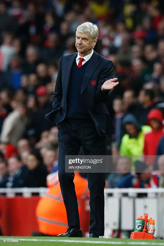 Arsenal's French manager Arsene Wenger gestures on the touchline during the English Premier League football match between Arsenal and Middlesbrough at the Emirates Stadium in London on October 22, 2016. / AFP / Ian KINGTON / RESTRICTED TO EDITORIAL USE. No use with unauthorized audio, video, data, fixture lists, club/league logos or 'live' services. Online in-match use limited to 75 images, no video emulation. No use in betting, games or single club/league/player publications. /