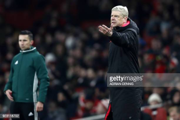 Arsenal's French manager Arsene Wenger gestures on the touchline during the second leg of the Europa League Round of 32 football match between...