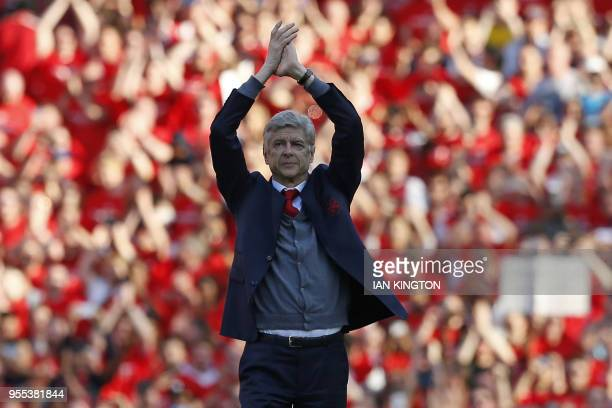 TOPSHOT Arsenal's French manager Arsene Wenger gestures to supporters on the pitch after the English Premier League football match between Arsenal...