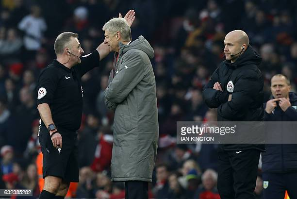 Arsenal's French manager Arsene Wenger is sent to the stands by English referee Jonathan Moss as fourth official Anthony Taylor looks on during the...