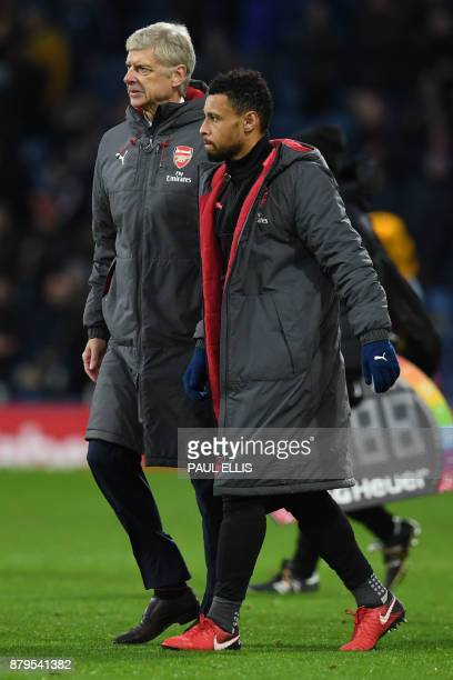 Arsenal's French manager Arsene Wenger L and Arsenal's Chilean striker Alexis Sanchez leave the pitch after the English Premier League football match...