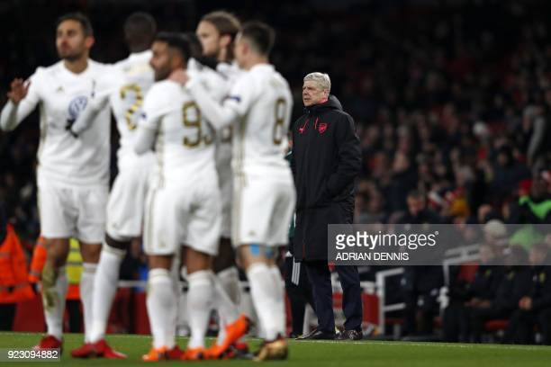 Arsenal's French manager Arsene Wenger looks on as Ostersunds' players celebrate a goal during the second leg of the Europa League Round of 32...