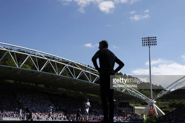 Arsenal's French manager Arsene Wenger looks on during the English Premier League football match between Huddersfield Town and Arsenal at the John...