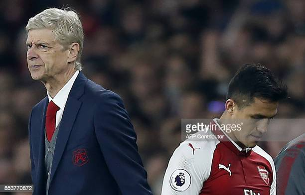 Arsenal's French manager Arsene Wenger reacts as Arsenal's Chilean striker Alexis Sanchez is substituted off of the pitch during the English Premier...