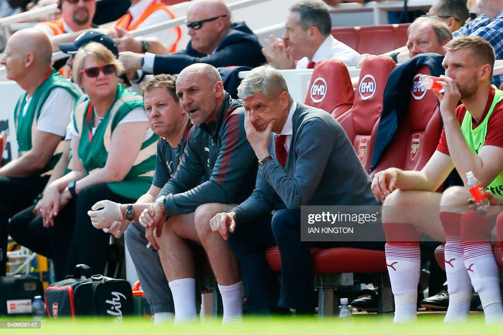 Arsenal's French manager Arsene Wenger reacts as he watches from his seat during the English Premier League football match between Arsenal and West Ham United at the Emirates Stadium in London on April 22, 2018. (Photo by Ian KINGTON / AFP) / RESTRICTED TO EDITORIAL USE. No use with unauthorized audio, video, data, fixture lists, club/league logos or 'live' services. Online in-match use limited to 75 images, no video emulation. No use in betting, games or single club/league/player publications. /