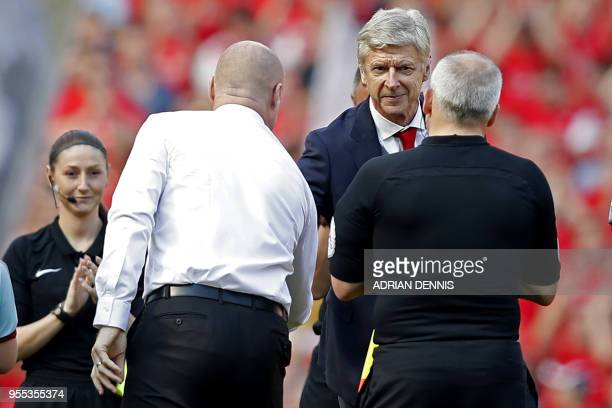 Arsenal's French manager Arsene Wenger shakes hands with Burnley's English manager Sean Dyche as he arrives for the English Premier League football...