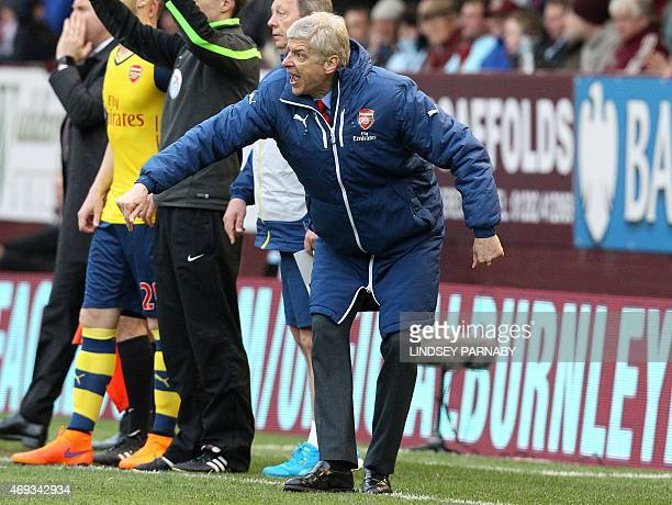 Arsenal's French manager Arsene Wenger shouts at his players during the English Premier League football match between Burnley and Arsenal at Turf...