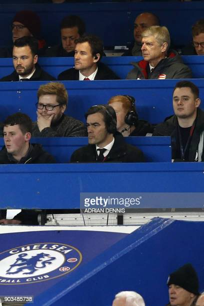 Arsenal's French manager Arsene Wenger sits beside Arsenal's former goalkeeper Jens Lehmann in the press box during the English League Cup semifinal...