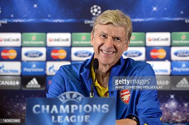 Arsenal's French manager Arsene Wenger smiles during a press conference at the Velodrome stadium in Marseille southern France on September 17 2013 on...