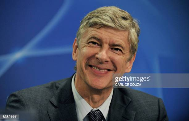 Arsenal's French Manager Arsene Wenger smiles during a press conference in Valencia on April 6 on the eve of a Champions League quarterfinal firstleg...