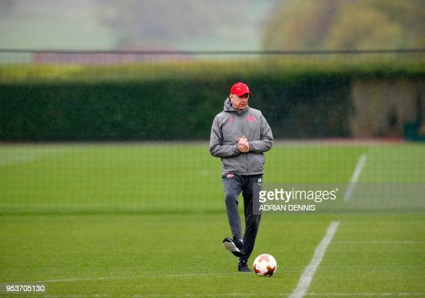 TOPSHOT Arsenal's French manager Arsene Wenger takes part in a training session at the club's complex in London Colney on May 2 2018 on the eve of...