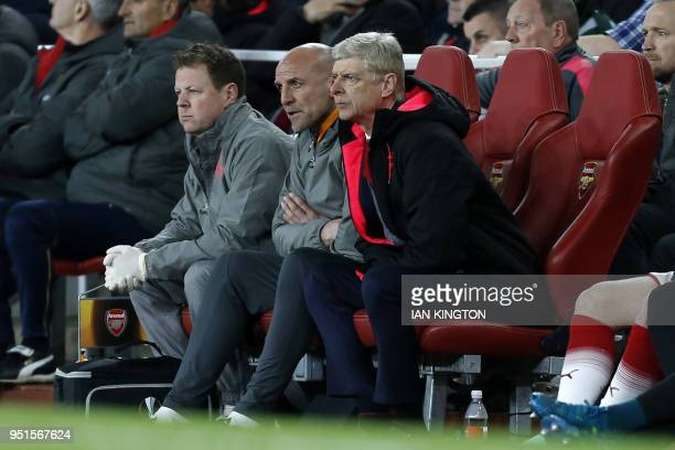 Arsenal's French manager Arsene Wenger watches from his seat during the UEFA Europa League first leg semifinal football match between Arsenal and...