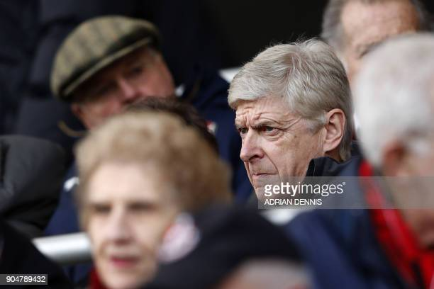 Arsenal's French manager Arsene Wenger watches from the stands during the English Premier League football match between Bournemouth and Arsenal at...