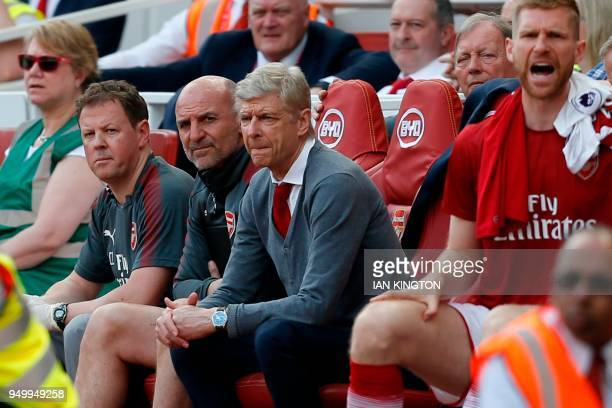 Arsenal's French manager Arsene Wenger watches on from his seat during the English Premier League football match between Arsenal and West Ham United...