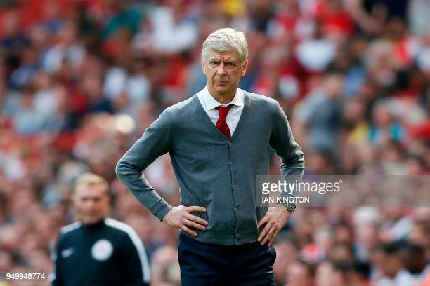 Arsenal's French manager Arsene Wenger watches on from the touch line during the English Premier League football match between Arsenal and West Ham...