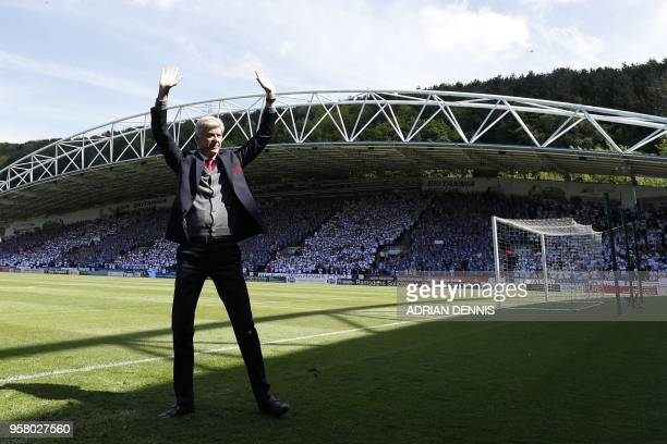 TOPSHOT Arsenal's French manager Arsene Wenger waves from the pitch before the English Premier League football match between Huddersfield Town and...