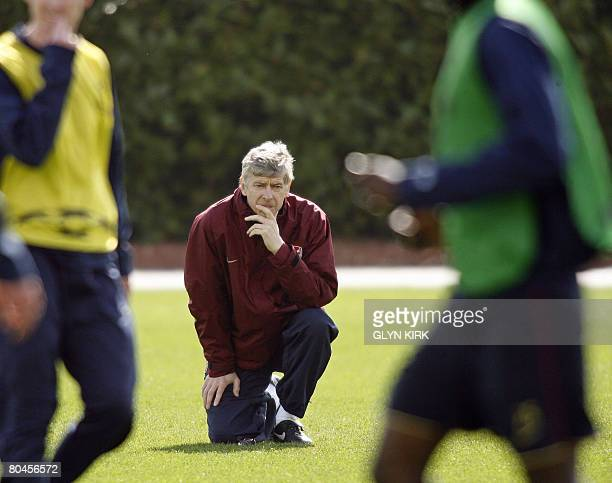Arsenal's French manager Ars?ne Wenger watches his team during training for the forthcoming UEFA Champions League quarter final first leg match...