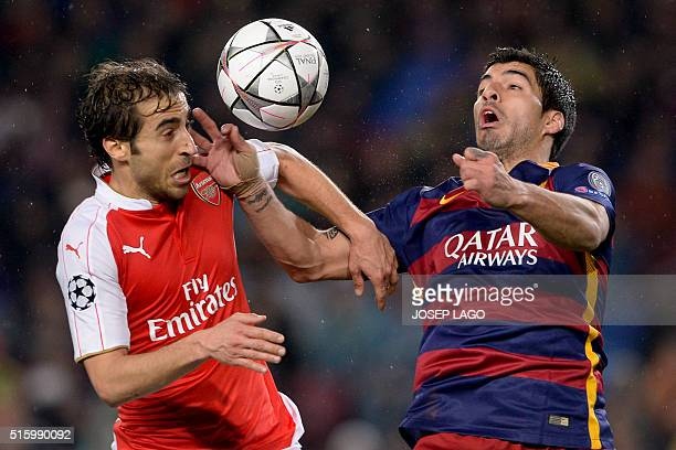 Arsenal's French midfielder Mathieu Flamini vies with Barcelona's Uruguayan forward Luis Suarez during the UEFA Champions League Round of 16 second...