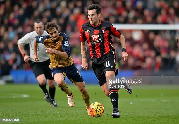 Arsenal's French midfielder Mathieu Flamini vies with Bournemouth's English midfielder Charlie Daniels during the English Premier League football...