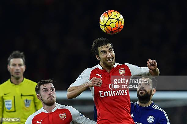 Arsenal's French midfielder Mathieu Flamini wins a header during the English Premier League football match between Arsenal and Chelsea at the...