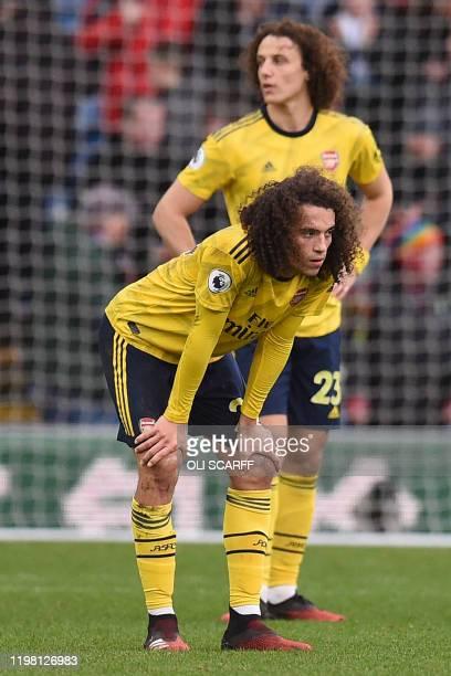 Arsenal's French midfielder Matteo Guendouzi ans Arsenal's Brazilian defender David Luiz react on the final whistle in the English Premier League...