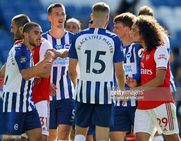 Arsenal's French midfielder Matteo Guendouzi challenges Brighton's French striker Neal Maupay after the English Premier League football match between...
