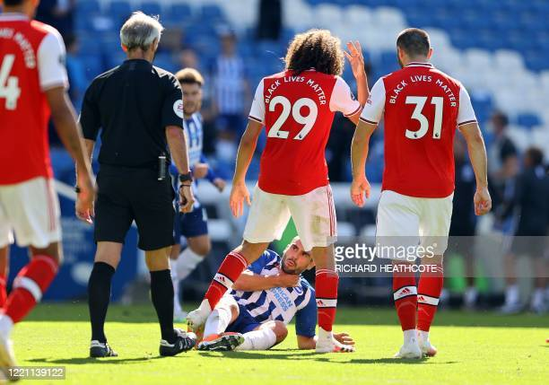 Arsenal's French midfielder Matteo Guendouzi challenges winning goalscorer Brighton's French striker Neal Maupay after the English Premier League...