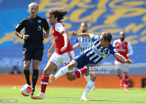 Arsenal's French midfielder Matteo Guendouzi fights for the ball with Brighton's Belgian midfielder Leandro Trossard during the English Premier...
