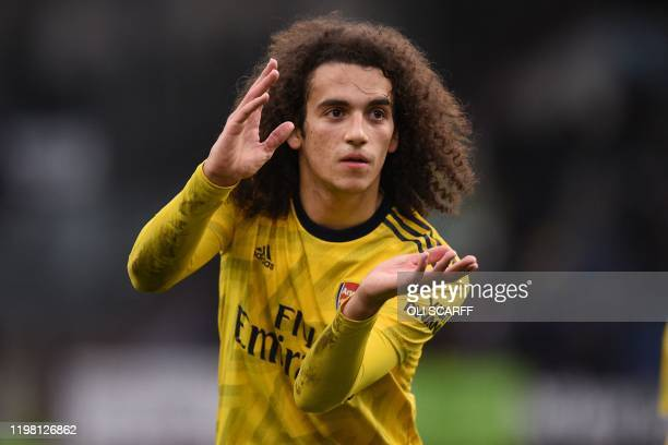 Arsenal's French midfielder Matteo Guendouzi gestures to supporters as he leaves after the English Premier League football match between Burnley and...