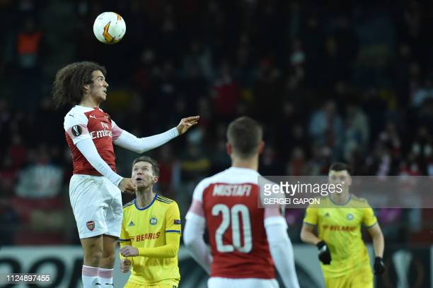 Arsenal's French midfielder Matteo Guendouzi heads the ball during the UEFA Europa League round of 32 first leg football match between FC BATE...