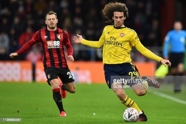 Arsenal's French midfielder Matteo Guendouzi runs away from Bournemouth's Scottish midfielder Ryan Fraser during the English FA Cup fourth round...