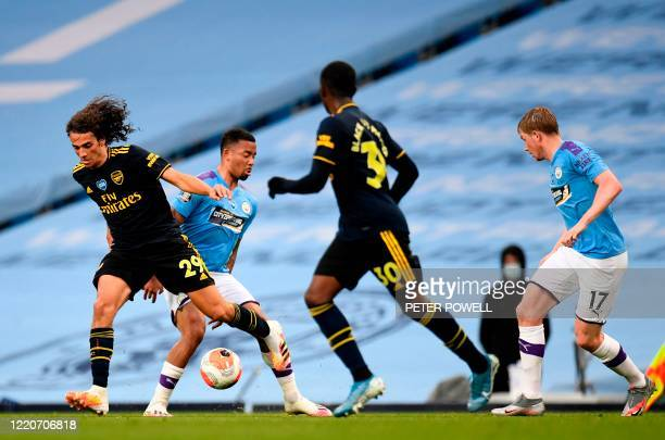Arsenal's French midfielder Matteo Guendouzi vies for the ball against Manchester City's Brazilian striker Gabriel Jesus during the English Premier...