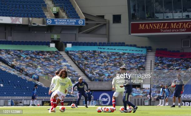 Arsenal's French midfielder Matteo Guendouzi warm up prior the English Premier League football match between Brighton Hove Albion and Arsenal at The...