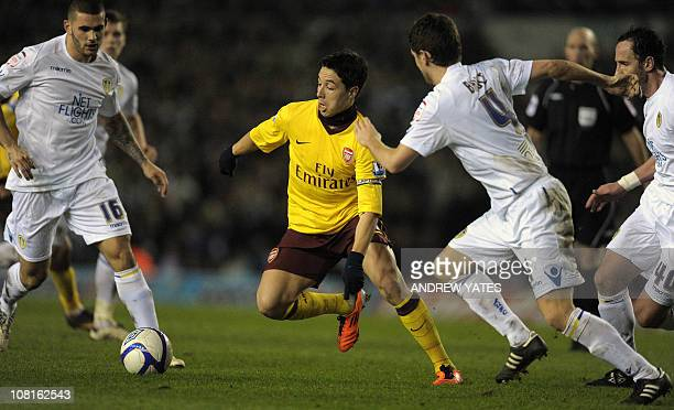 Arsenal's French midfielder Samir Nasri vies with the Leeds defenders during the FA Cup third round replay football match at Elland Road Leeds...