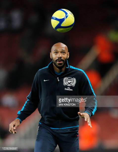 Arsenal's French player Thierry Henry, on loan from New York Red Bulls, warms up before kick off and starts as a substitute during the third round FA...