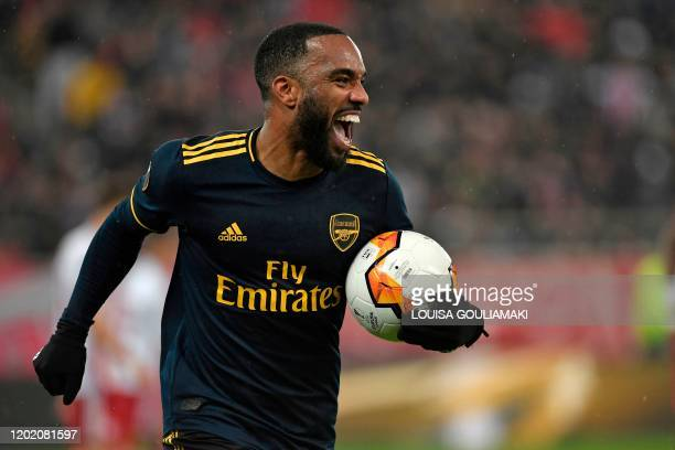 Arsenal's French striker Alexandre Lacazette celebrates after he scores the opening goal of the UEFA Europa League round of 32 first leg football...