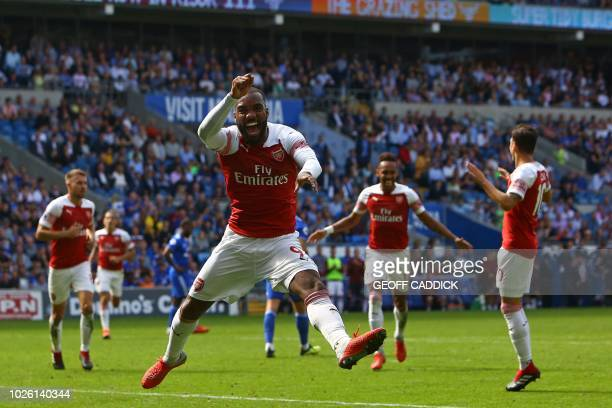 TOPSHOT Arsenal's French striker Alexandre Lacazette celebrates after playing the assist for their second goal scored by Arsenal's Gabonese striker...
