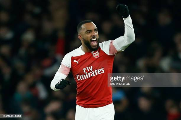 Arsenal's French striker Alexandre Lacazette celebrates after scoring the opening goal of the English Premier League football match between Arsenal...