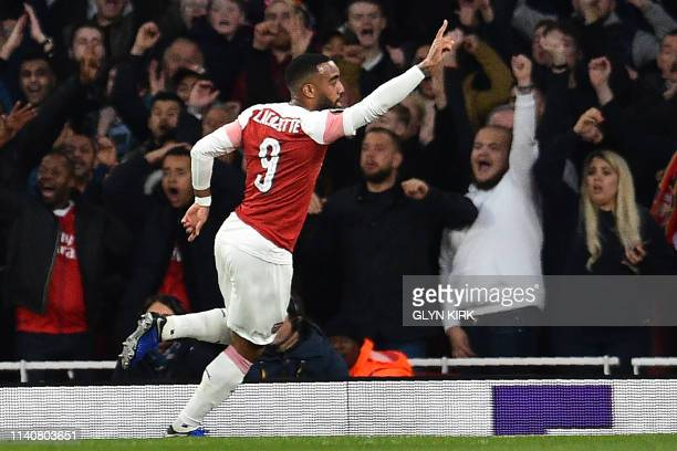 Arsenal's French striker Alexandre Lacazette celebrates after scoring the second goal during the UEFA Europa League semi final first leg football...