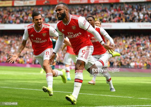 TOPSHOT Arsenal's French striker Alexandre Lacazette celebrates after scoring the opening goal of the English Premier League football match between...