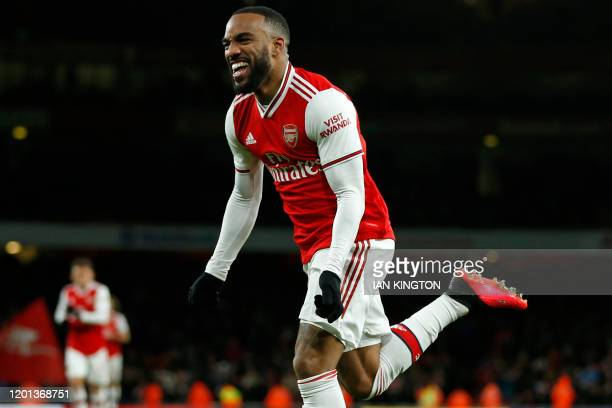 Arsenal's French striker Alexandre Lacazette celebrates after scoring their fourth goal during the English Premier League football match between...