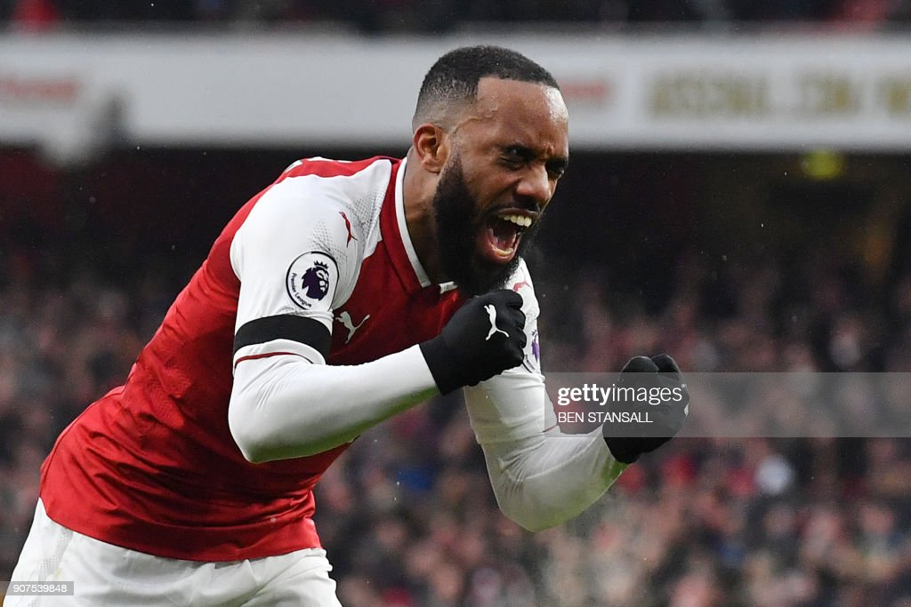 Arsenal's French striker Alexandre Lacazette celebrates after scoring their fourth goal during the English Premier League football match between Arsenal and Crystal Palace at the Emirates Stadium in London on January 20, 2018. / AFP PHOTO / Ben STANSALL / RESTRICTED TO EDITORIAL USE. No use with unauthorized audio, video, data, fixture lists, club/league logos or 'live' services. Online in-match use limited to 75 images, no video emulation. No use in betting, games or single club/league/player publications. /