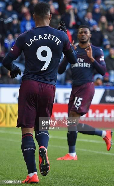 Arsenal's French striker Alexandre Lacazette celebrates scoring his team's second goal with Arsenal's English midfielder Ainsley MaitlandNiles goal...