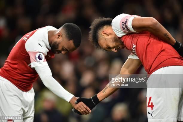 TOPSHOT Arsenal's French striker Alexandre Lacazette celebrates scoring his team's second goal with Arsenal's Gabonese striker PierreEmerick...