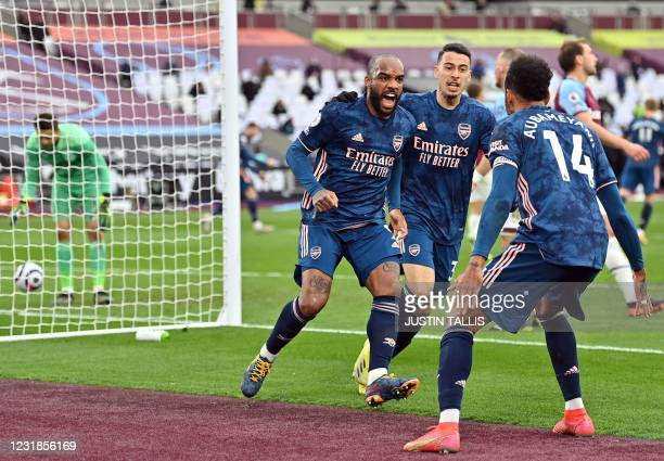 Arsenal's French striker Alexandre Lacazette celebrates scoring his team's third goal during the English Premier League football match between West...