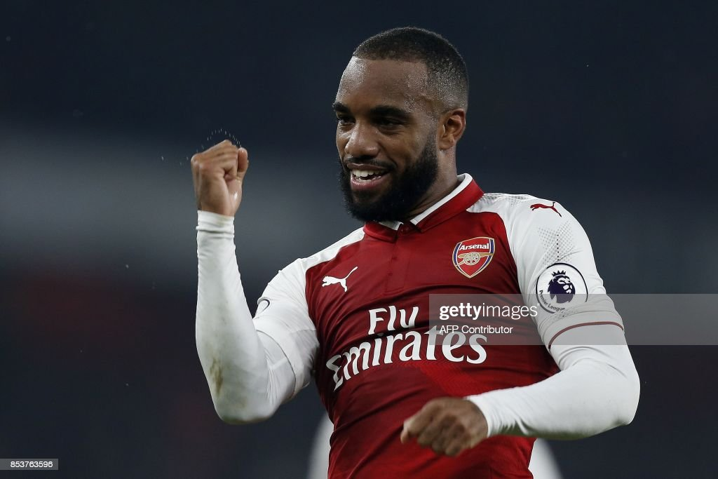 Arsenal's French striker Alexandre Lacazette celebrates scoring his team's second goal from the penalty spot during the English Premier League football match between Arsenal and West Bromwich Albion at the Emirates Stadium in London on September 25, 2017. / AFP PHOTO / Ian KINGTON / RESTRICTED TO EDITORIAL USE. No use with unauthorized audio, video, data, fixture lists, club/league logos or 'live' services. Online in-match use limited to 75 images, no video emulation. No use in betting, games or single club/league/player publications. /