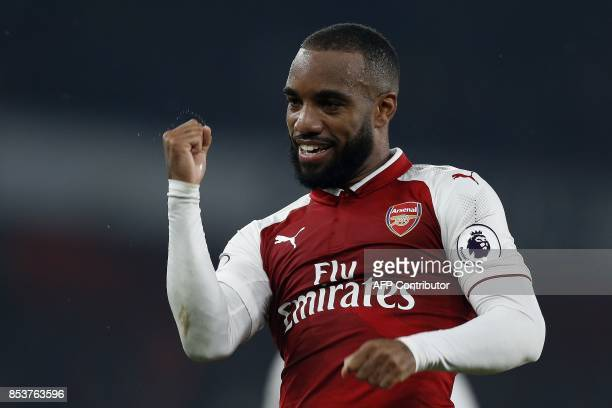 Arsenal's French striker Alexandre Lacazette celebrates scoring his team's second goal from the penalty spot during the English Premier League...