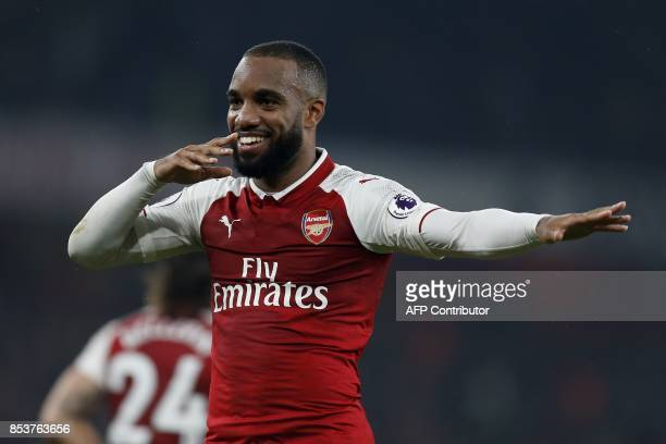 TOPSHOT Arsenal's French striker Alexandre Lacazette celebrates scoring his team's second goal from the penalty spot during the English Premier...