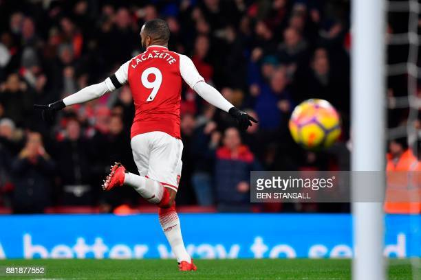 Arsenal's French striker Alexandre Lacazette celebrates scoring the opening goal during the English Premier League football match between Arsenal and...